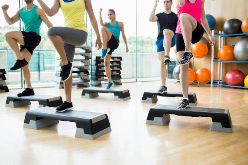 fitness-class-exercising-in-the-studio-at-the-gym-2